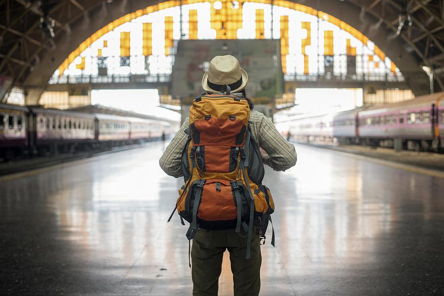 Traveler Man Waits Train On Railway Platform. Photograph by Boonchai Wedmakawand