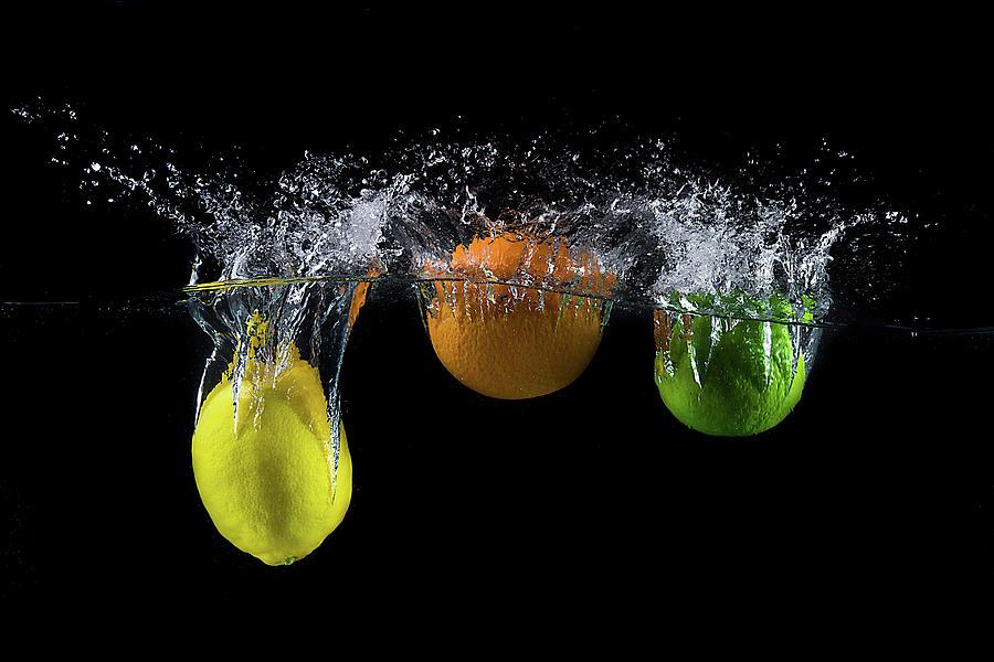 Splash Photograph - Triple Citrus Splash by Mogyorosi Stefan