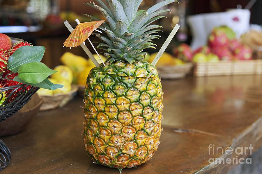 Bar Photograph - Tropical Pineapple Drink by Brandon Tabiolo