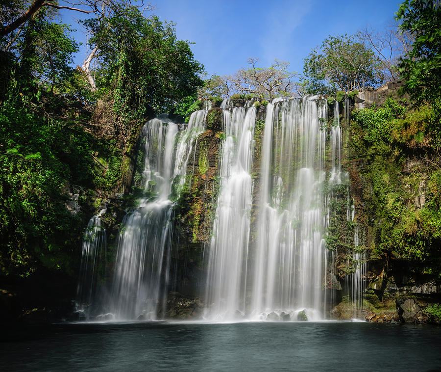 Tropical Waterfall On A Sunny Day Photograph by Ogphoto