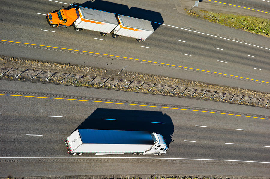 Color Image Photograph - Trucks Moving On A Highway, Interstate by Panoramic Images