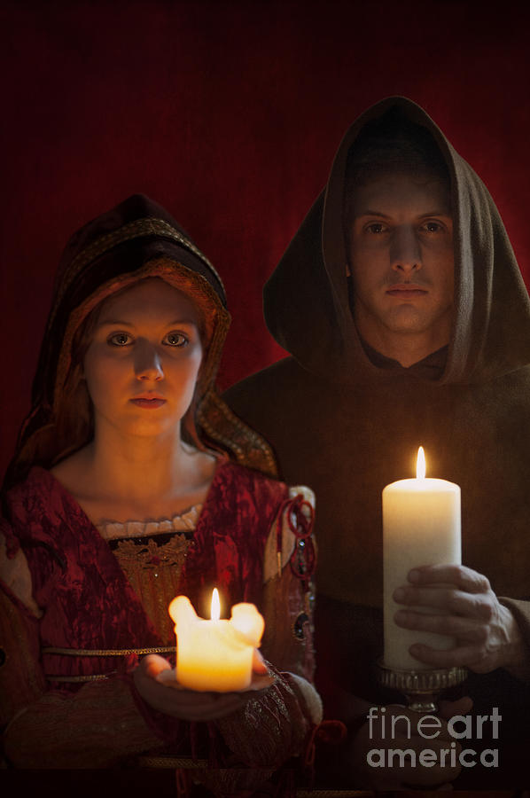 Medieval Photograph - Tudor Medieval Young Attractive Couple  Holding  Candles by Lee Avison