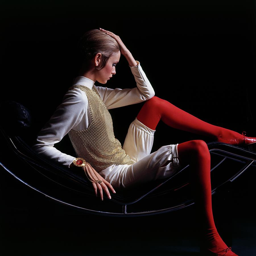 Twiggy Sitting On A Modern Chair Photograph by Bert Stern