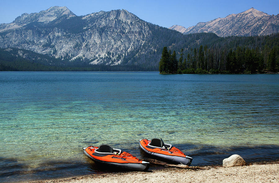 Twin Kayaks On The Shore Of A Pristine Photograph by Timothy Hearsum