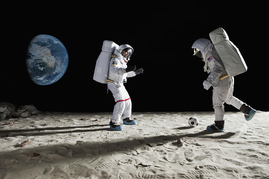 Two Astronauts Playing Soccer On The Moon Photograph by fStop Images - Caspar Benson