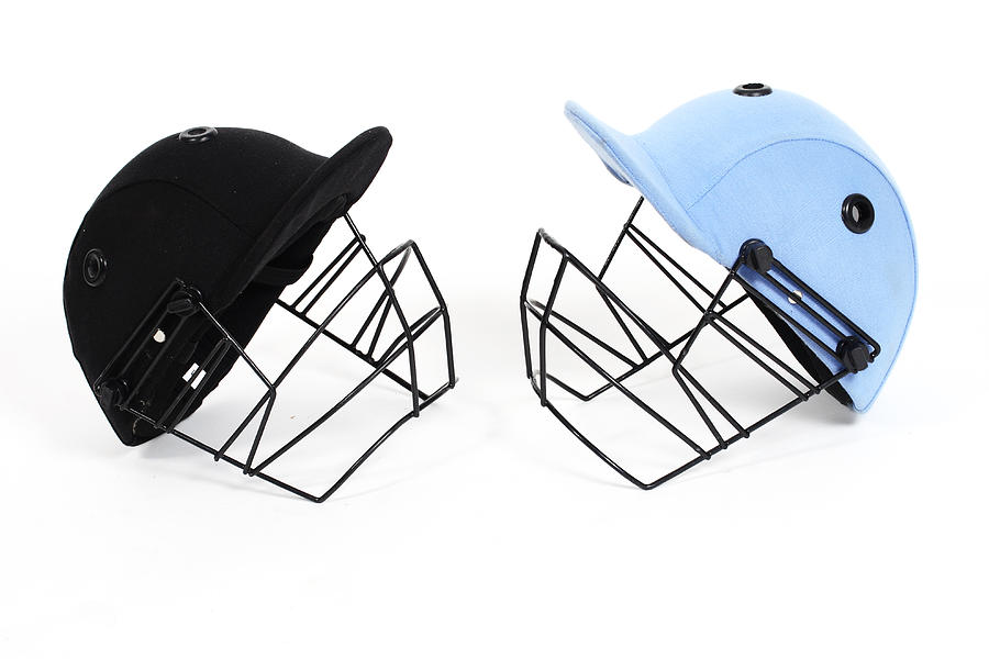 Two Cricket Helmets Facing Each Other Photograph by Visage