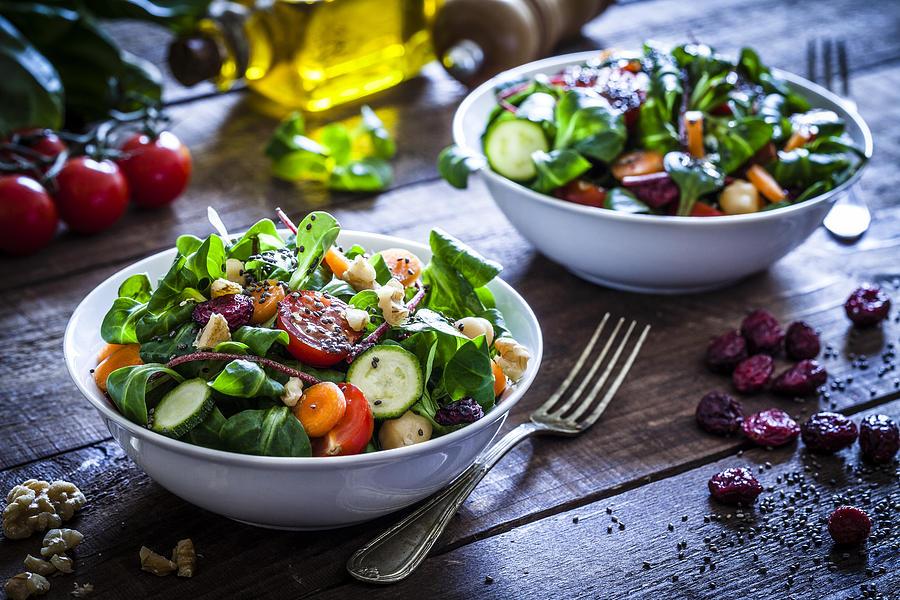 Two fresh salad bowls Photograph by Fcafotodigital