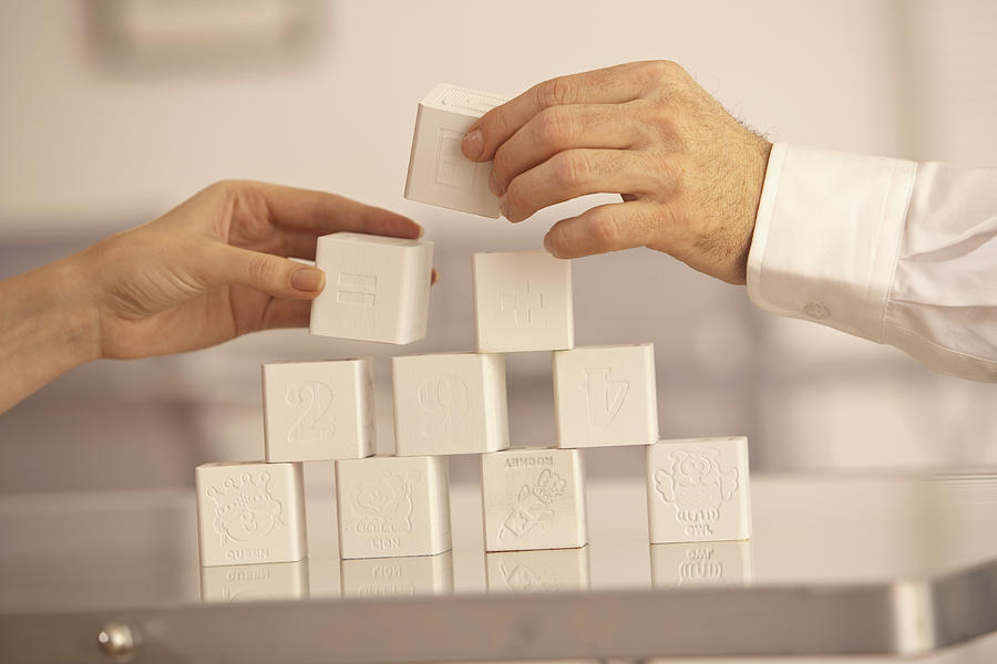 Two Hands Building Blocks Photograph by Comstock Images