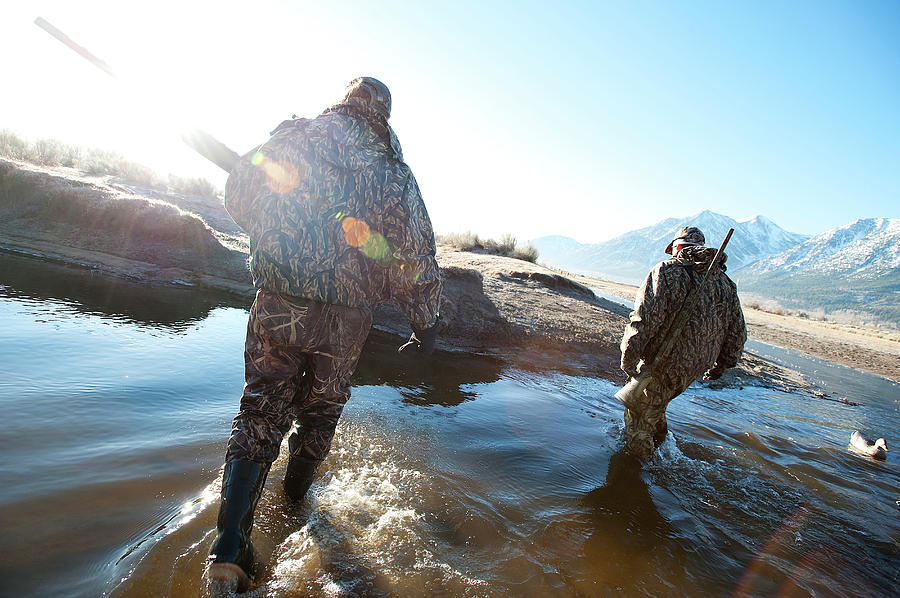 Anticipation Photograph - Two Hunters Track Geese In Nevada by Corey Rich
