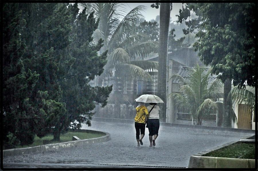 Umbrella Photograph - Two Ladies With One Umbrella by Achmad Bachtiar