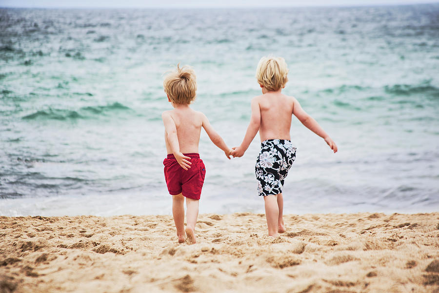 Two Little Boys Running To The Sea Photograph by Sally Anscombe