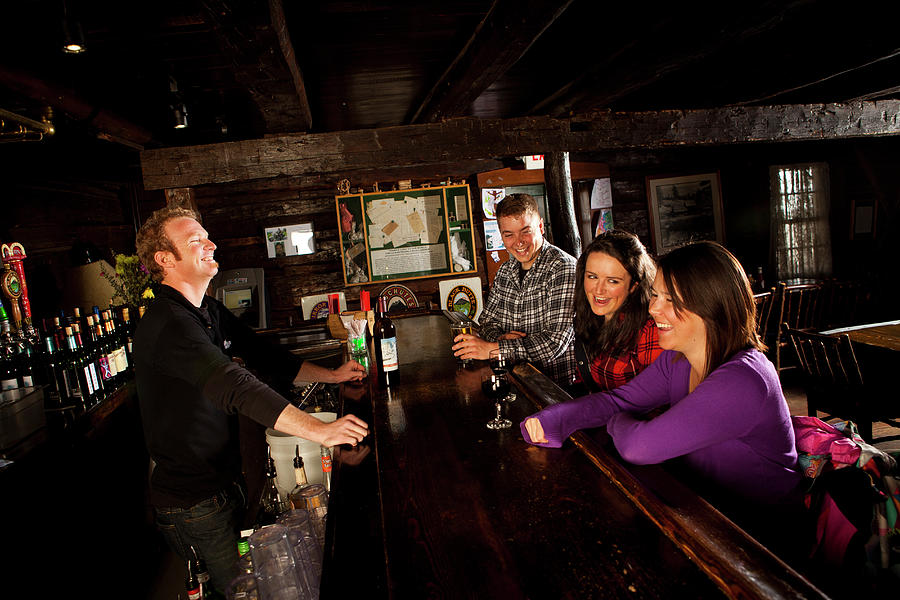 Bar Photograph - Two Men And Two Women Having Beer by Trevor Clark
