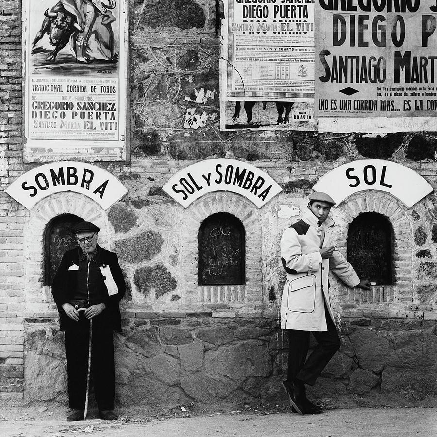 Two Men Posing By A Wall Covered In Spanish Photograph by Chadwick Hall
