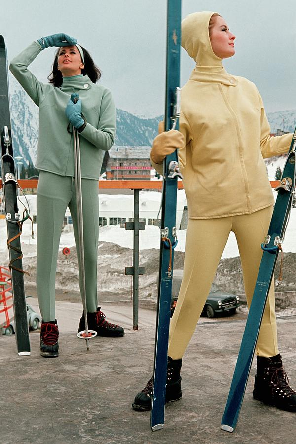 Two Models At A Ski Resort Wearing Outfits Photograph by Frances McLaughlin-Gill