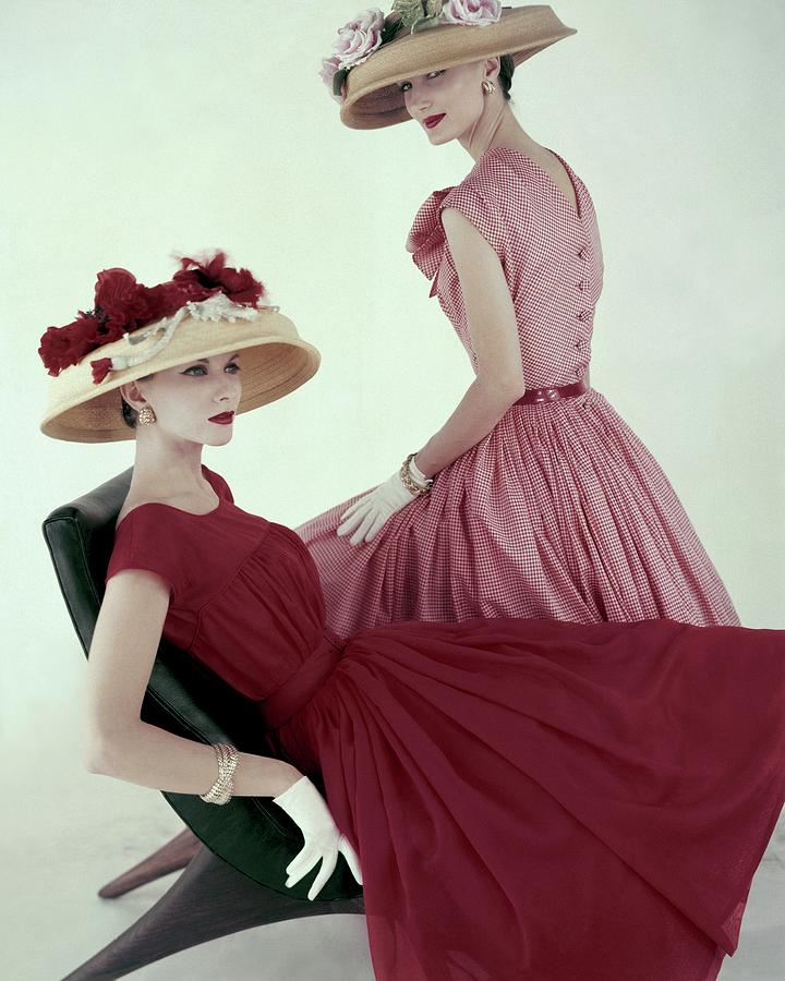 Two Models Wearing Red Dresses Photograph by Karen Radkai