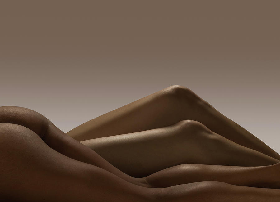 Two Pairs Of Nude Female Legs Photograph by Jonathan Knowles