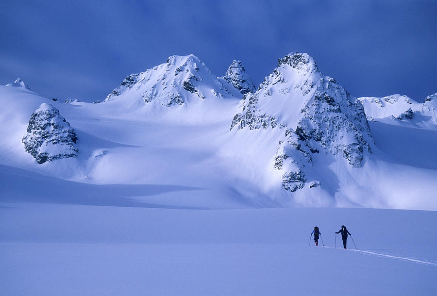 Adventure Photograph - Two Skiers Ski Tour And Explore by Jimmy Chin
