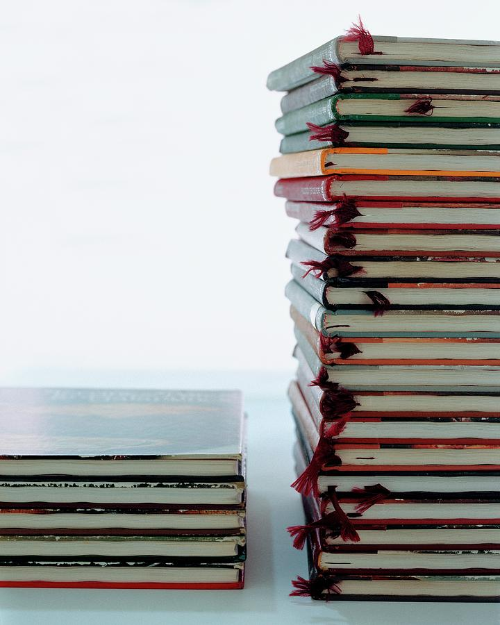 Two Stacks Of Books by Romulo Yanes