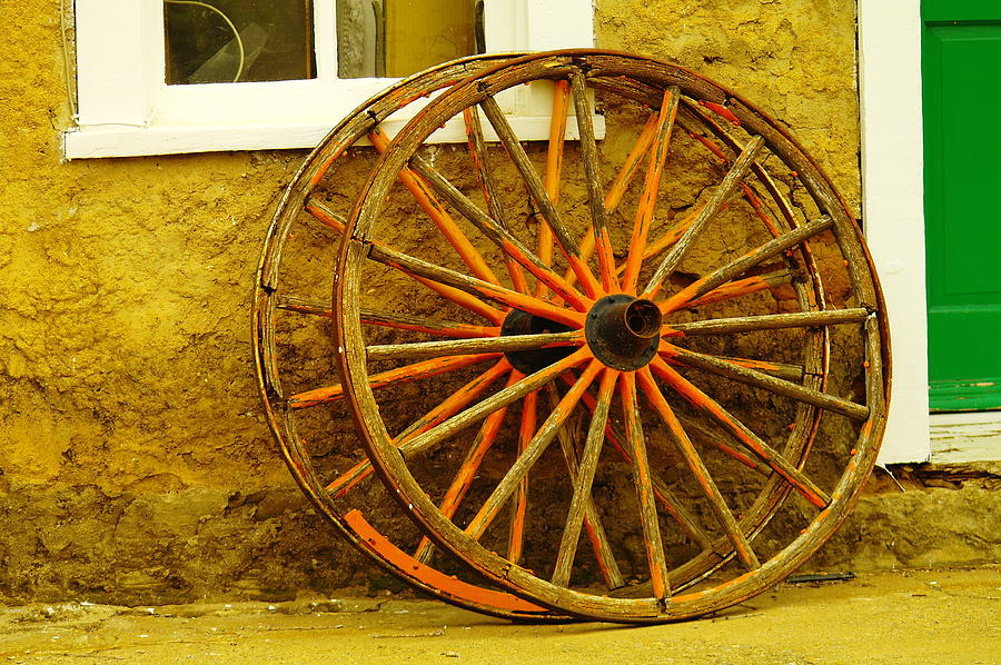 Wheels Photograph - Two Wagon Wheels by Jeff Swan
