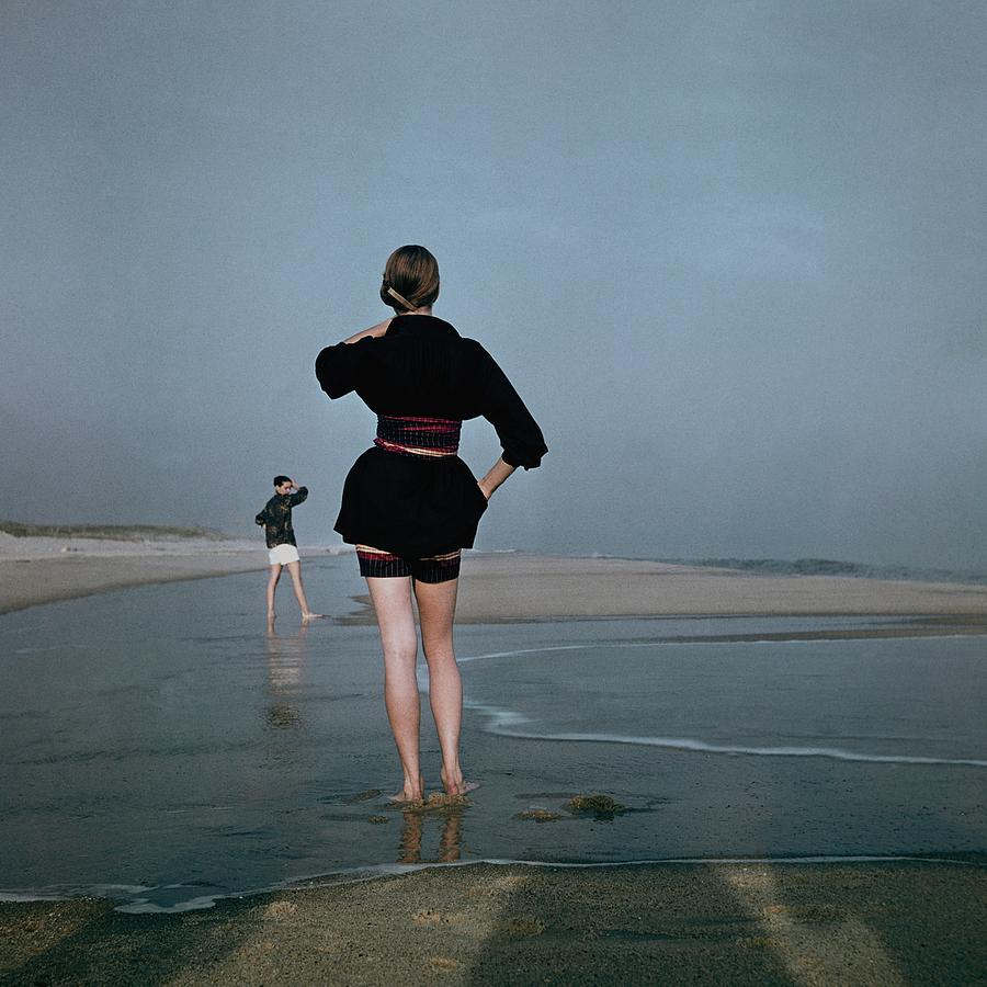 Two Women At A Beach Photograph by Serge Balkin