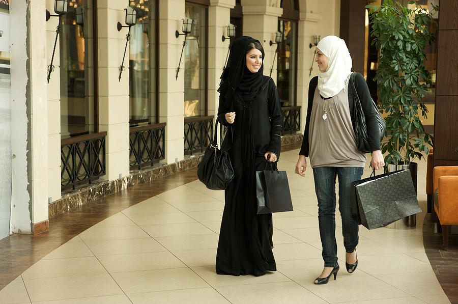 Two women shopping. Photograph by Svetlana Zibnitskaya