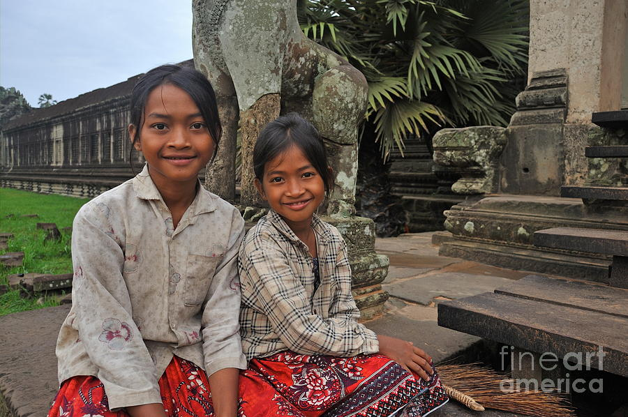 Children Photograph - Two Young Cambodian Girls In Angkor Wat by Sami Sarkis