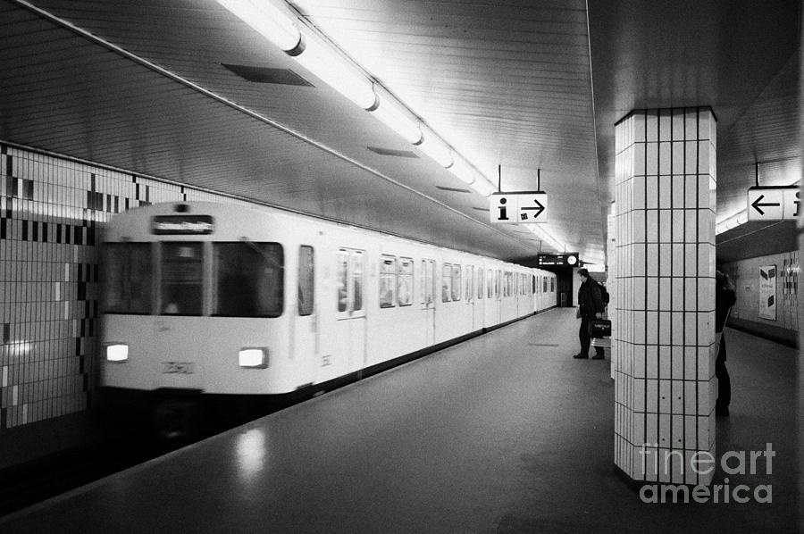Berlin Photograph - u-bahn train pulling in to ubahn station Berlin Germany by Joe Fox