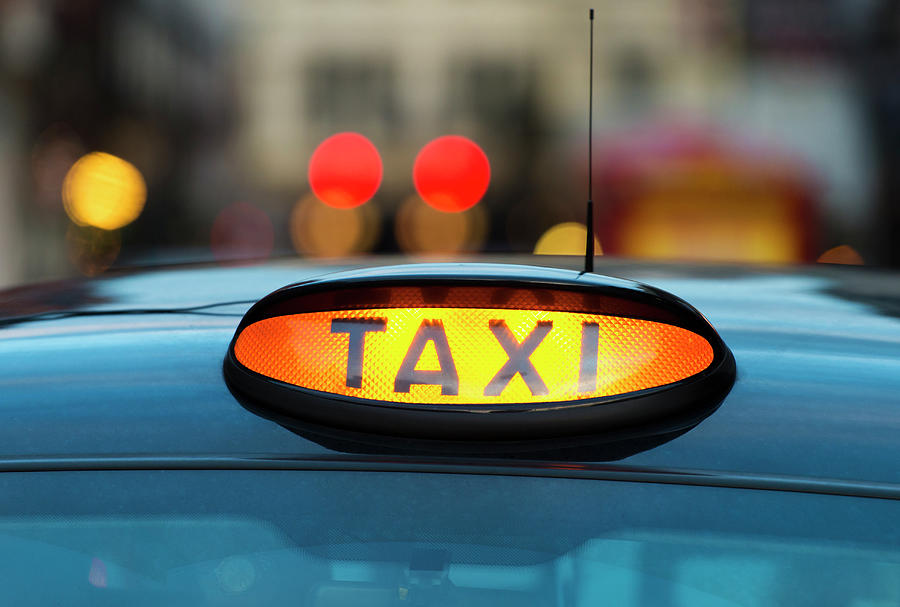 Uk, England, London, Sign On Taxi Cab Photograph by Tetra Images