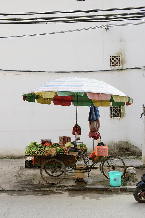 Umbrella Over Fruit Cart On City Street Photograph by Cultura Exclusive/matt Dutile