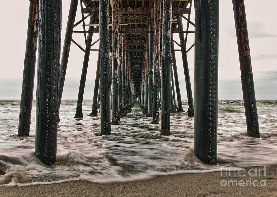 Under The Pier Photograph - Under The Pier by Eddie Yerkish