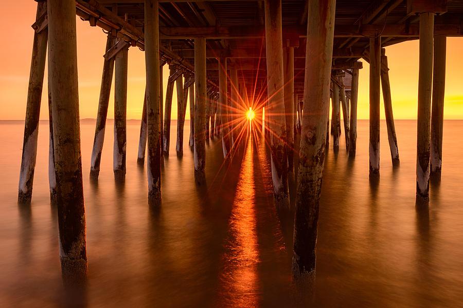 Beach Photograph - Under The Pier by Michael Blanchette