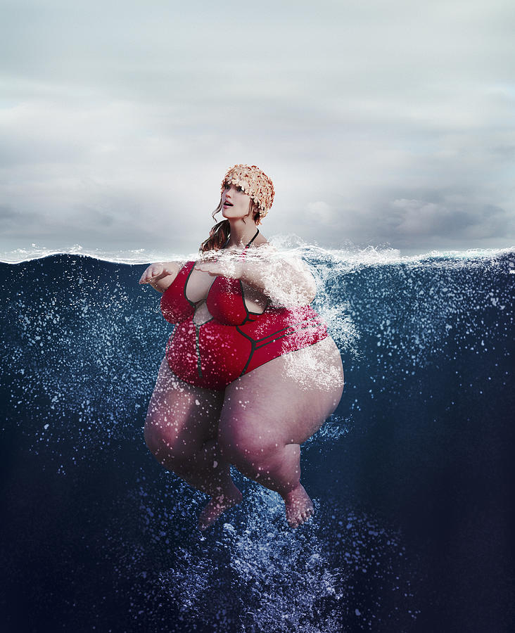 Underwater review of overweight woman swimming Photograph by Donald Iain Smith