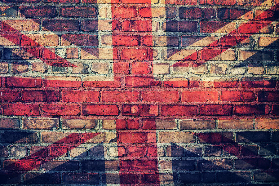 Union Jack Flag On  Brick Wall Photograph by Sally Anscombe