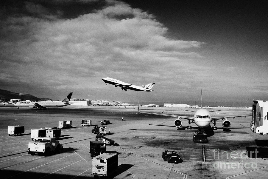 United Photograph - united airlines aircraft taking off taxiing and on stand at the San Francisco International Airport  by Joe Fox