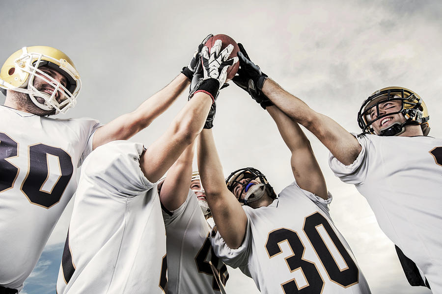 Unity Of American Football Players Photograph by Skynesher