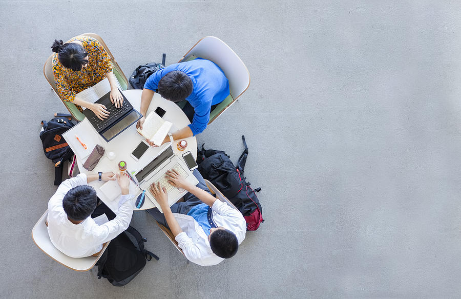 University Students Studying In A Group Photograph by Recep-bg
