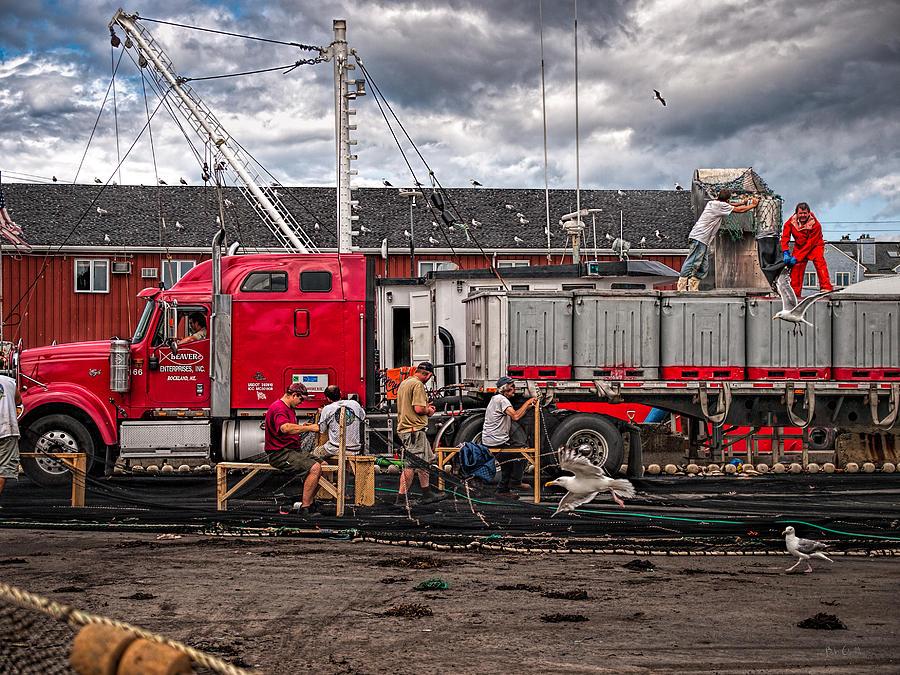 Trucks Photograph - Unloading Fish And Mending Nets by Bob Orsillo
