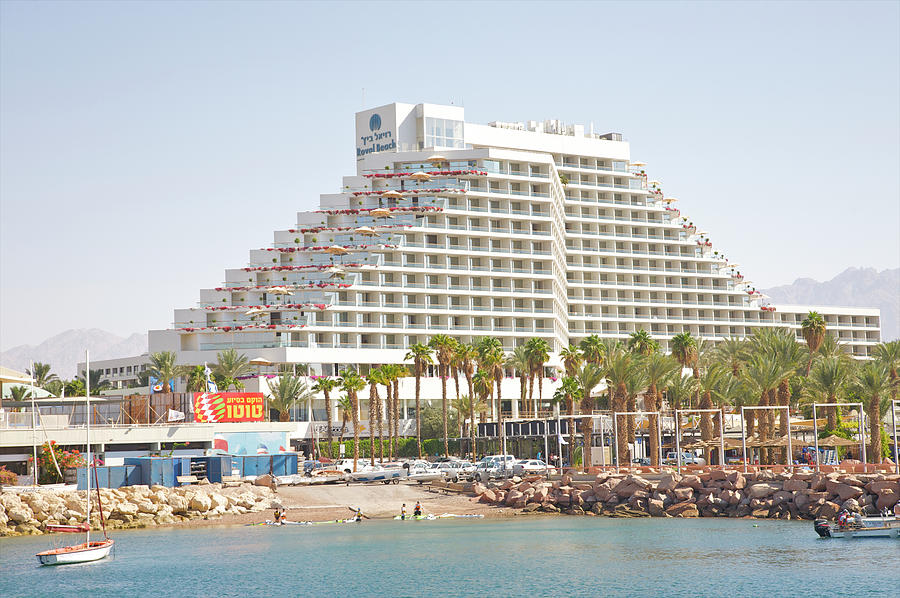 Unusual Shape To Modern Hotel On Red Sea Photograph by Barry Winiker