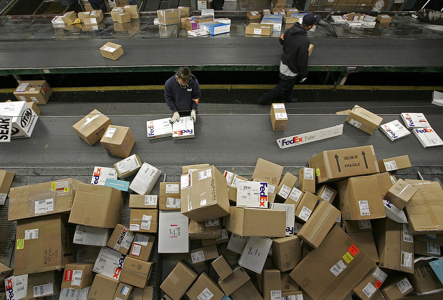 UPS And FedEx Deliver Packages As Holiday Shopping Season Begins Photograph by Justin Sullivan