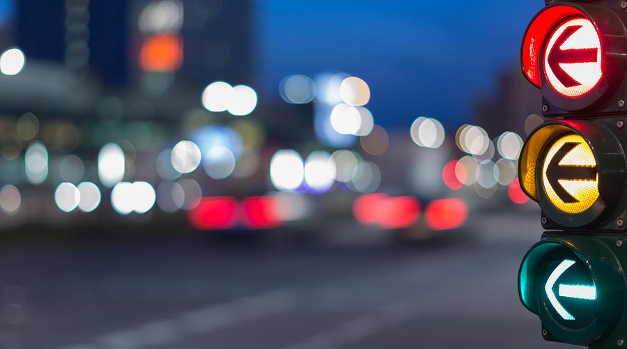 Urban City Street Szene With Colorful Traffic Lights And Bokeh Night Lights Photograph by Matthias Makarinus