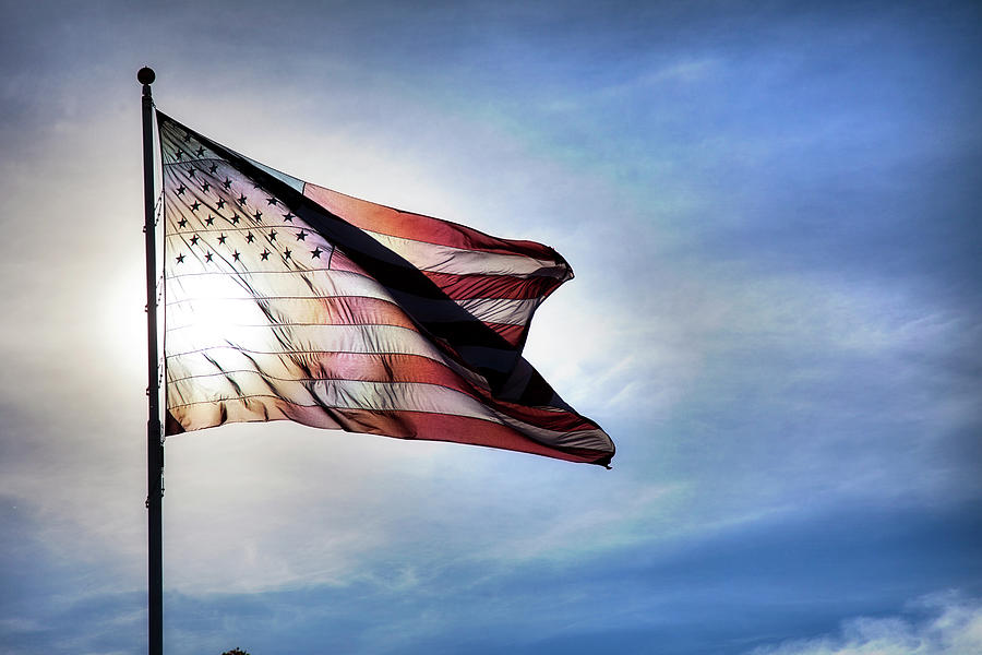 Us Flag Fluttering In Backlit Blue Sky Photograph by Strickke