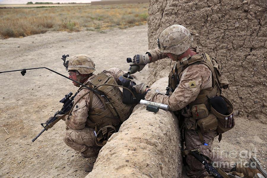 Military Photograph - U.s. Marine Fills A Camelbak Bladder by Stocktrek  Images fd461b38b793