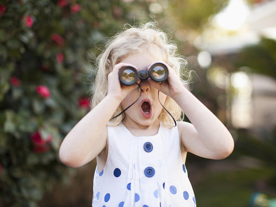 Usa, California, Los Angeles, Surprised Young Girl (4-5) Looking Through Binoculars Photograph by Tetra Images - Jessica Peterson