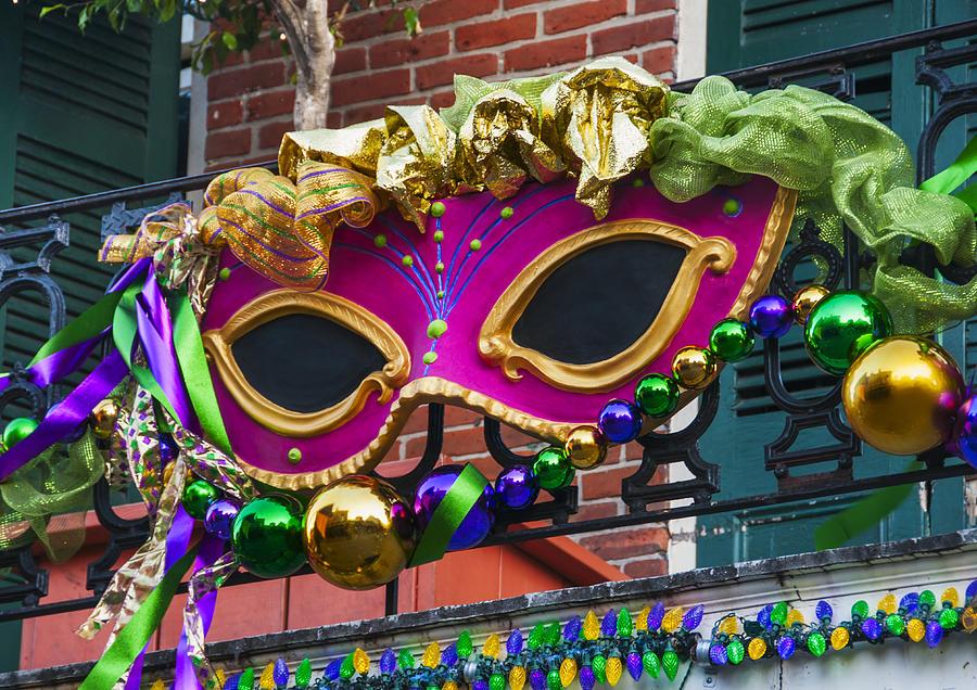 Usa, New Orleans, Louisiana, Mardi Gras Mask Hanging On Balconys Railing Photograph by Daniel Grill