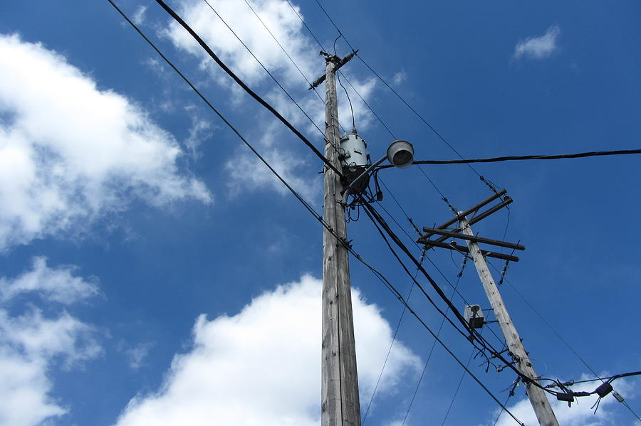 Utility Poles And Clouds 11 Photograph