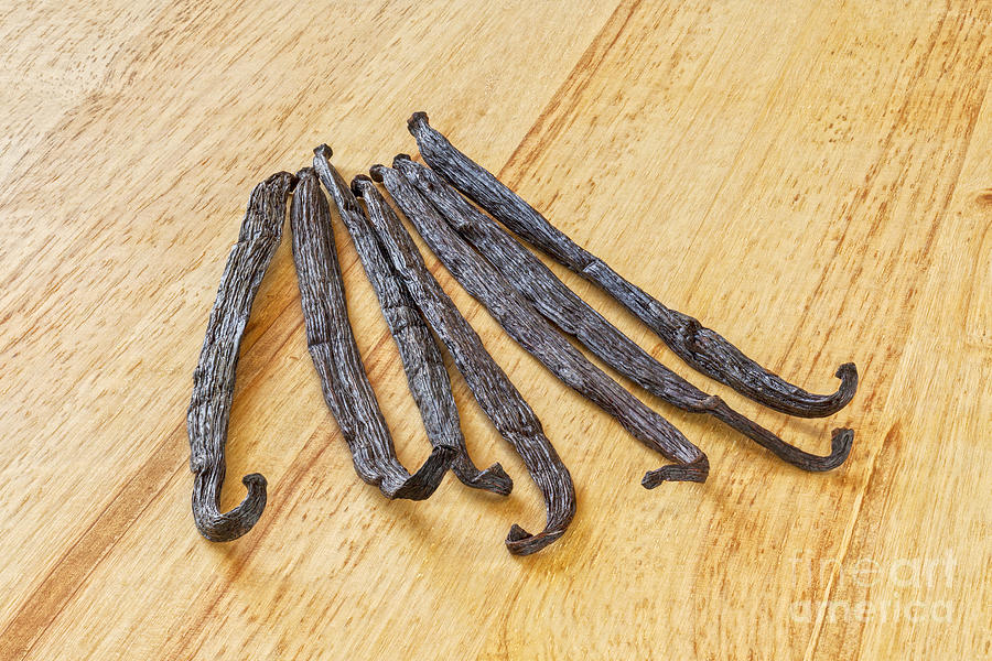 Vanilla Photograph - Vanilla Beans On A Wooden Surface by Colin and Linda McKie