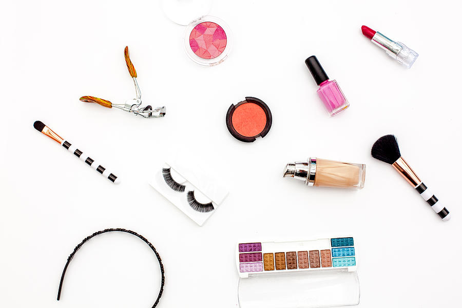 various makeup products and cosmetics in white background.Top view Photograph by Carol Yepes