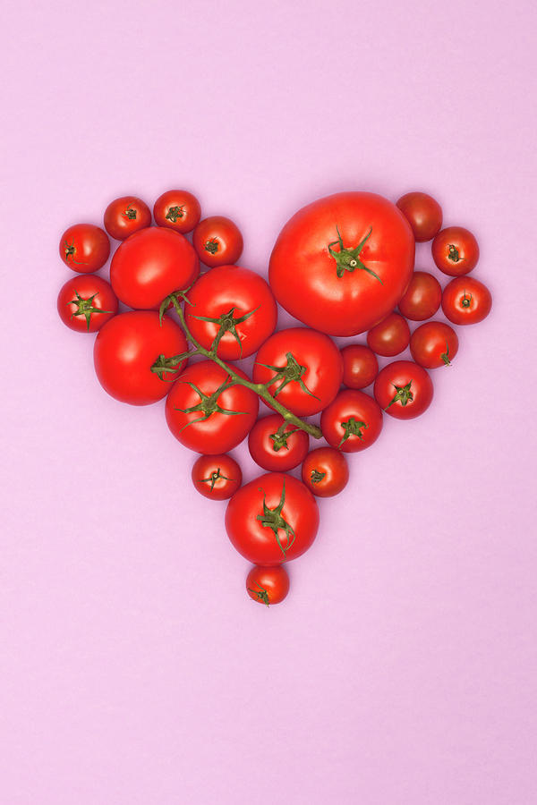 Various Sizes Of Tomatoes Arranged Into Photograph by Larry Washburn