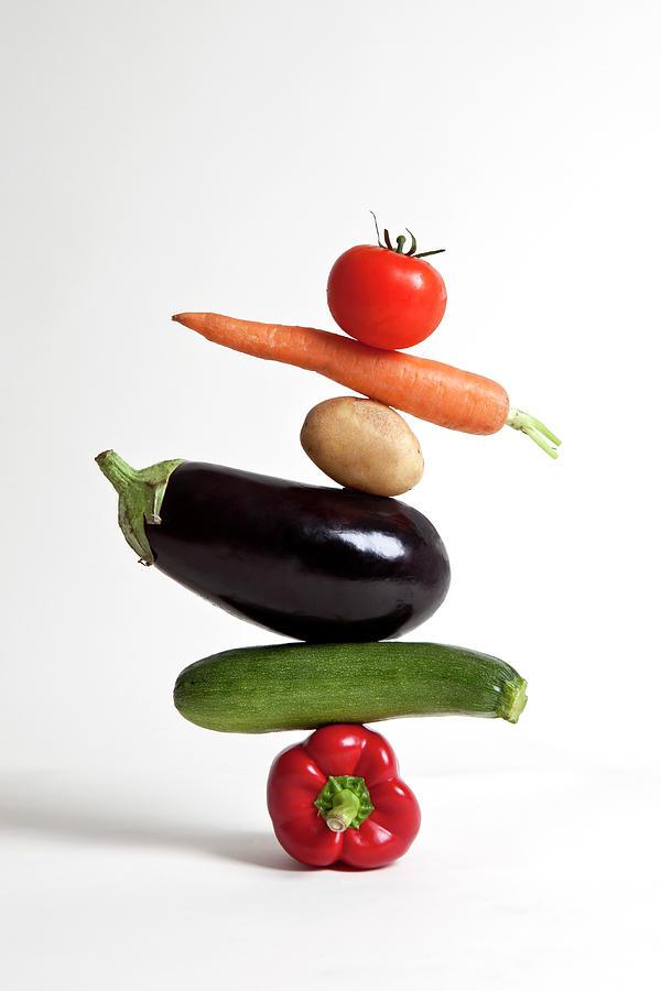 Vegetables Arranged In A Stack Photograph by Halfdark