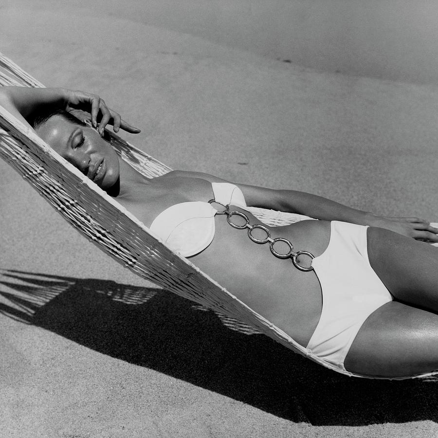 Veruschka Von Lehndorff Lying In A Hammock Photograph by Franco Rubartelli